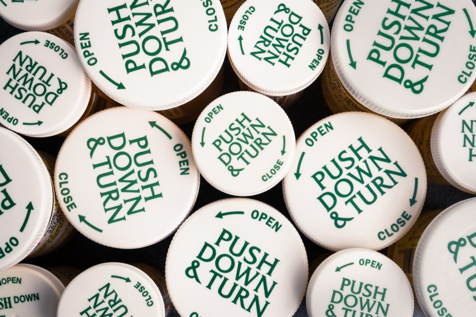 "Tops of pill bottles, which say ""Push Down & Turn""."